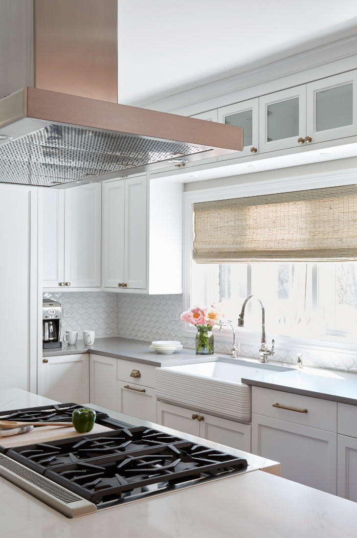 kitchen-stove-with-stainless-steel-hood-on-island