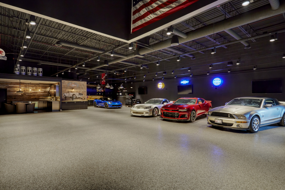 cars-lined-up-in-garage-man-cave-red-blue-white-silver-sports-car